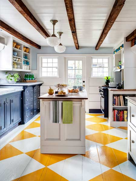 A pop of brightness is brought into a kitchen. via Up to Date Interiors