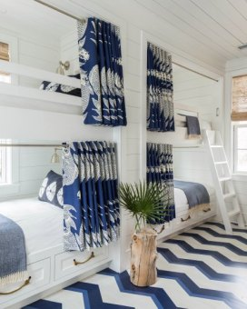 The colors used to paint this floor tie back into the rooms aesthetic. via Coastal Living