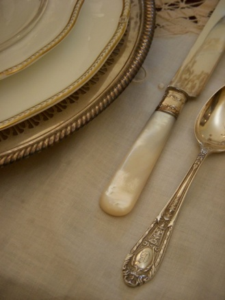 Family heirlooms, these pearl handled knives and antique silver add refinement.