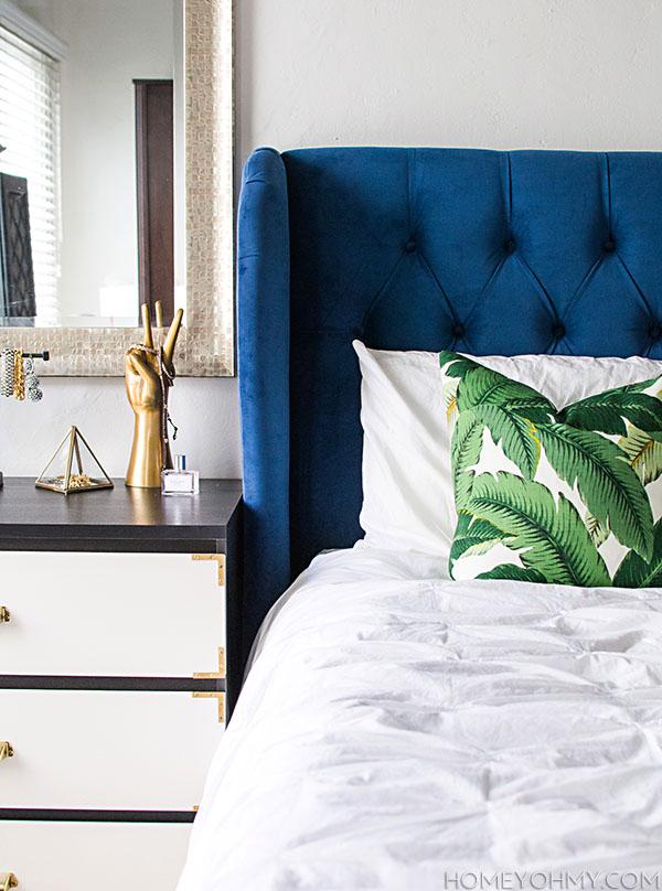 Blue-headboard-and-banana-leaf-pillow.jpg